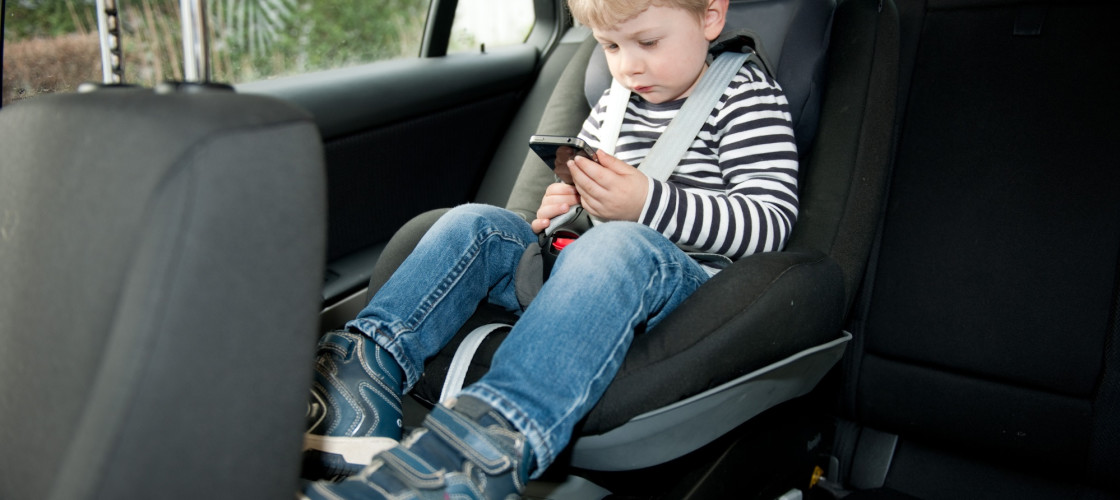 Child on phone in car seat