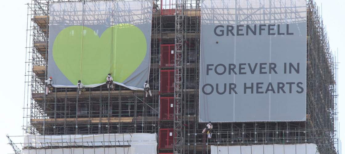 Banners are unveiled on the outside of Grenfell Tower in west London.