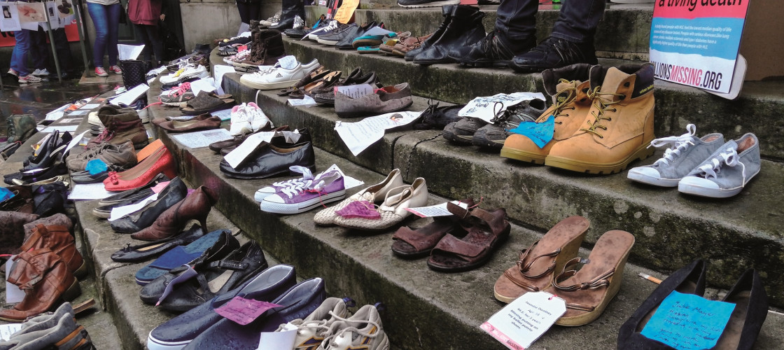 "Empty pairs of shoes, representing a patient of ME, were on display at a ""Millions Missing"" rally in May"