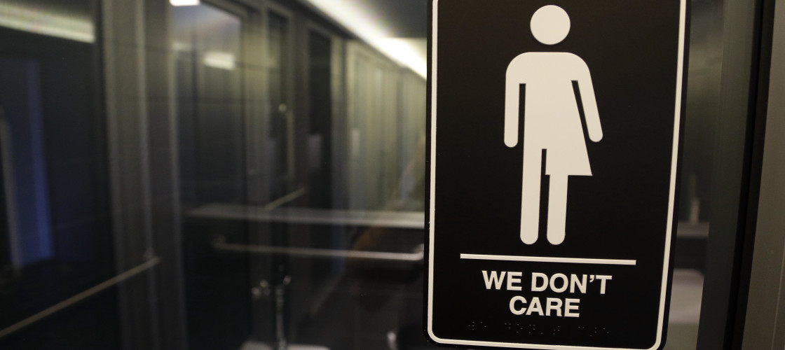 'We Don't Care' bathroom sign