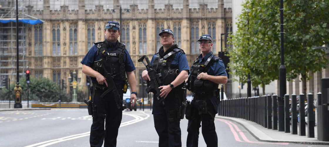 Armed police on Victoria Embankment in Westminster, central London