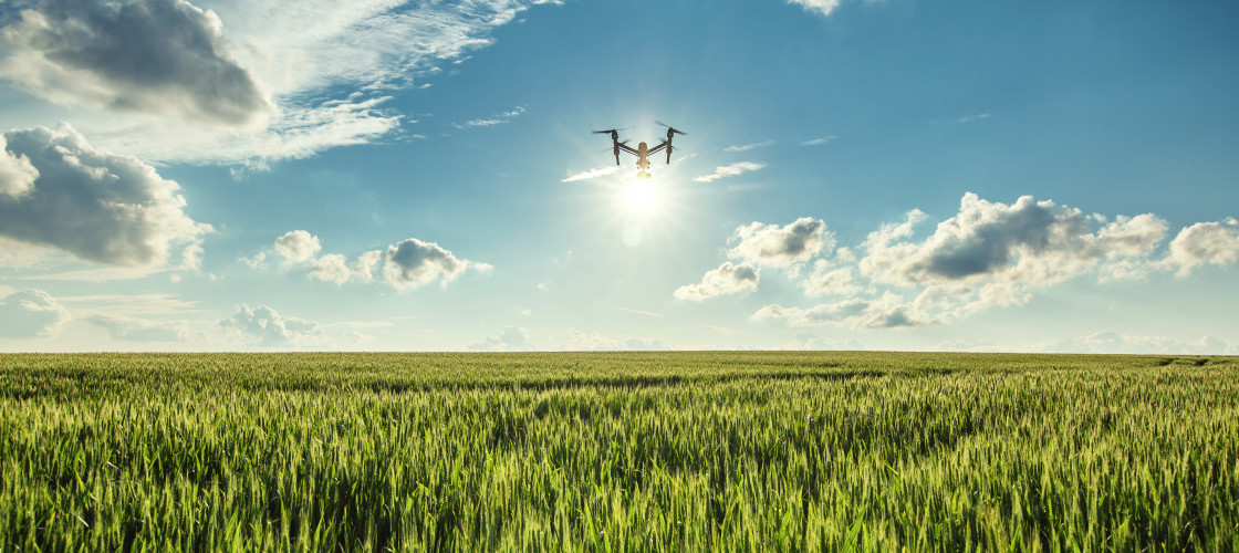 A drone flies above AGRI Stock