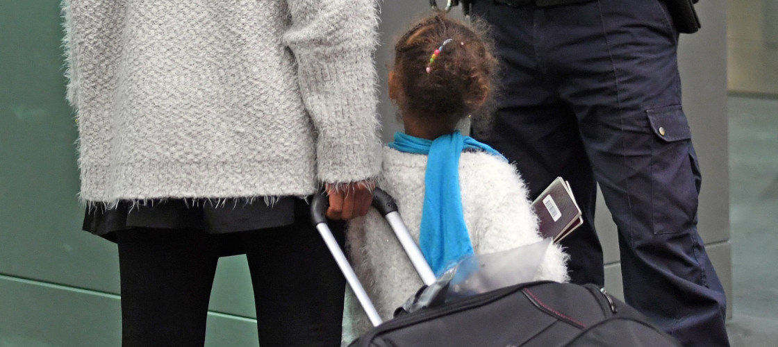 A young child travels through Border Control