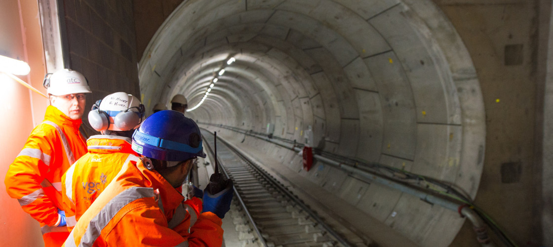 Crossrail workers in a train tunnel at the construction site of the a Crossrail station