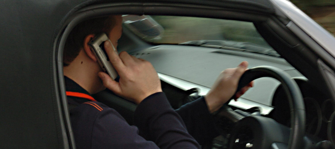 Motorist using his phone while driving