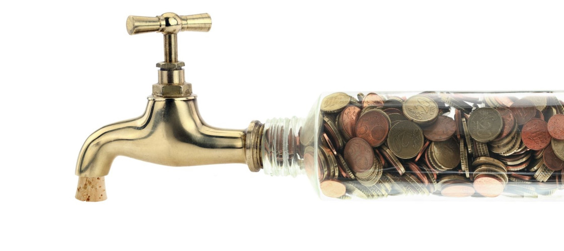 A tap backed up with coins in a pipe