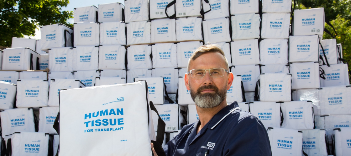 A doctor holds a transplant box