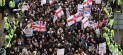 English Defence League members march through Luton