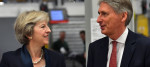 Theresa May and Philip Hammond visit a Land Rover factory last September