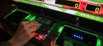 A woman uses a gambling machine