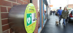An emergency defibrillator on a wall in a British city center