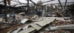 A factory in Yemen's capital Sanaa lies in ruins after a Saudi-led air strike last year