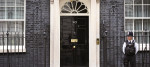 A police officer stands outside No.10