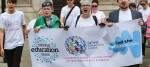 Protesters hold a National Education Union banner during a demonstration to End the Send Crisis in London UK