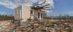 Tree logs can be seen piercing through the roof of a home in Freeport, Bahamas after Hurricane Dorian