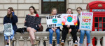Students are seen holding placards during a climate change protest in London as they highlight the dangers of climate change.