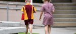 Young school students, a boy and a girl, are seen at a state primary school