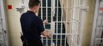 A guard closes a door at a young offender's institute