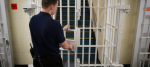 A guard closes a door at a young offenders institution