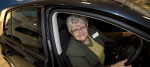 A woman sits in her Motability car