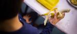A child eats a banana