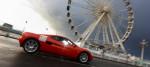 A low emission car drives through Brighton