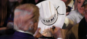 Donald Trump signs a Cowboy hat
