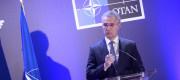 Jens Stoltenberg stands at a Nato platform