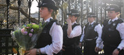Policewomen holding flowers