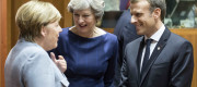 Theresa May talking to Angela Merkel and Emmanuel Macron at the European Council yesterday