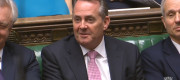 International Trade Secretary Liam Fox listens as Prime Minister Theresa May speaks during PMQs