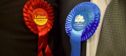 Labour and Tory rosettes