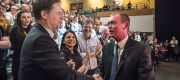 Tim Farron and Nick Clegg shake hands at a Lib Dem conference in York