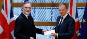 UK ambassador Tim Barrow handing the Article 50 letter to Donald Tusk