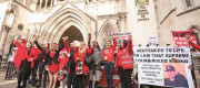 Members of the Joint Enterprise Not Guilty by Association group demonstrate outside the Royal Courts of Justice, London