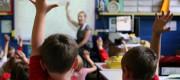 Teacher addresses children in a classroom