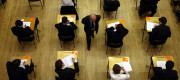 Pupils sitting exams in an exam hall