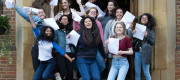 Students jump for joy as they celebrate their A Level results from the King Edwards VI High School for Girls Edgbaston, Birmingham.