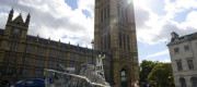 A boat made of plastics sits outside parliament