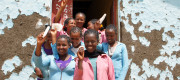 Students of the Wuchale school stand in front of their school holding menstrual pads in their hands in Muka Turi, North of Adiis Abeba, Ethiopia