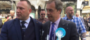 Nigel Farage with milkshake on his jacket