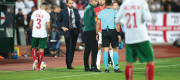 Match referee Ivan Bebek speaks to England manager Gareth Southgate and Harry Kane with regards to racist chanting from fans during the UEFA Euro 2020 Qualifying match in Sofia