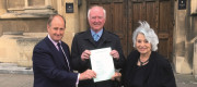 (left to right) Kevin Hollinrake MP, Peter Lawrence and Baroness Hamwee holding a copy of Claudia's Law