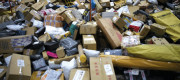 A pile of thousands of parcels in a warehouse