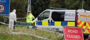 Officers attend the scene where a police officer was killed at a reported burglary in Berkshire