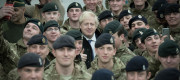 Boris Johnson addresses British soldiers after serving Christmas lunch to British troops stationed in Estonia