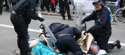 Police attempt to separate a pair of XR protesters who have glued themselves to each other
