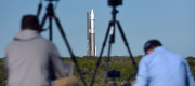 Members of the media take photographs as a United Launch Alliance Atlas V 411 rocket with the Solar Orbiter payload rolls out from the vertical integration facility to pad 41 at Cape Canaveral Air Force Station