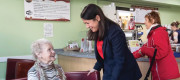 Lisa Nandy speaks to a member of the public during a visit to the Crossing Cafe in Worksop