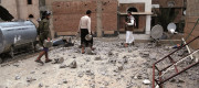 People clear debris after airstrikes hit Sanaa, Yemen